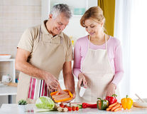Senior Couple in the kitchen Royalty Free Stock Images