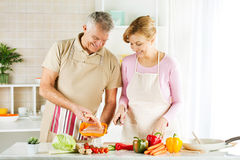 Senior Couple in the kitchen Royalty Free Stock Photography