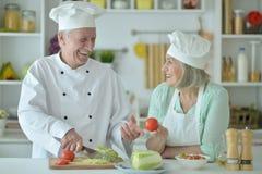Senior couple at kitchen Stock Photo