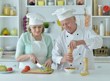 Senior couple at kitchen. Portrait of a senior couple at kitchen  cooking Royalty Free Stock Photo