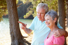 Senior couple at lake together Royalty Free Stock Photo