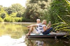 Senior couple at lakeshore Stock Image