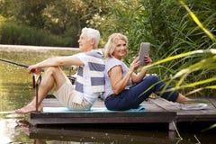 Senior couple at lakeshore Stock Photo