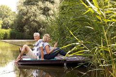 Senior couple at lakeshore Royalty Free Stock Image