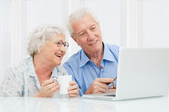 Senior couple at laptop royalty free stock photography