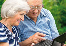 Senior couple with  laptop Royalty Free Stock Photo