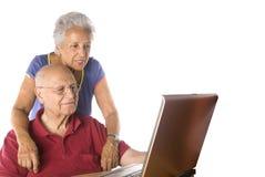 Senior couple on laptop. On white background Stock Image