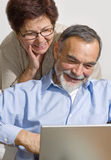 Senior couple on laptop Stock Photography