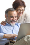 Senior couple on laptop Stock Photo