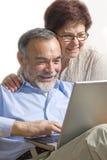 Senior couple on laptop Stock Photo