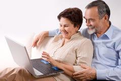 Senior couple on laptop stock image