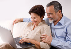 Senior couple on laptop Royalty Free Stock Photography