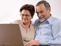 Senior couple on laptop Stock Image