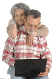 Senior couple with laptop computer Stock Photo