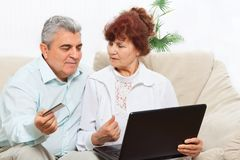 Senior couple laptop credit card Royalty Free Stock Photo