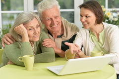 Senior couple  with laptop Stock Images