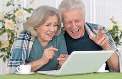 Senior couple  with laptop Stock Image