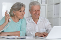 Senior couple  with laptop. Portrait of a senior couple working with laptop Royalty Free Stock Photo