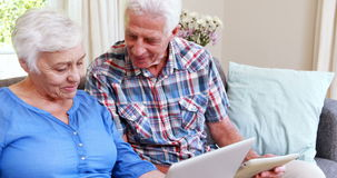 Senior couple on laptop and tablet stock footage