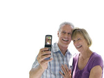 senior couple laughing looking at mobile phone, cut out Royalty Free Stock Photos
