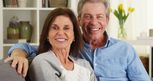 Senior couple laughing and talking to camera Stock Image