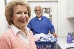 Senior Couple With Laundry In Bathroom stock photos