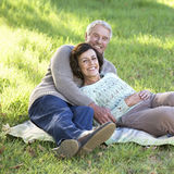 A senior couple laying on a rug Royalty Free Stock Image