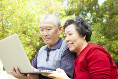 Senior couple learning with laptop Stock Photo