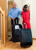 Senior couple leaving the home Stock Photos