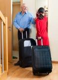 Senior couple leaving the home Stock Photos