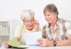 Senior couple with letter Stock Photography