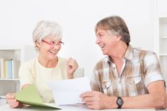 Senior couple with letter Stock Image
