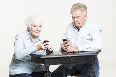 Senior couple listens to music Stock Photography