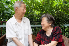 A senior couple look at each other. Royalty Free Stock Image