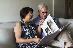 Senior Couple Look Photo Album Stock Image