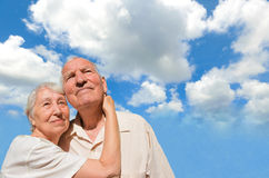 Senior couple looking in a blue sky Royalty Free Stock Images