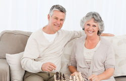 Senior couple looking at the camera Royalty Free Stock Photos