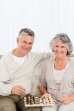 Senior couple looking at the camera at home Royalty Free Stock Images