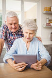 Senior couple looking at a digital tablet Stock Image