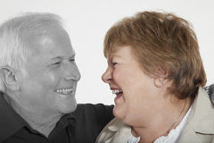 Senior couple looking at each other against white background Stock Photography