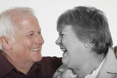 Senior couple looking at each other against white background Royalty Free Stock Photos