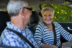 Senior couple looking at each other in car. Senior couple looking at each other while siting in car Royalty Free Stock Image