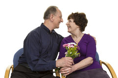 Senior Couple Looking At Each Other Holding Bouquet Royalty Free Stock Image
