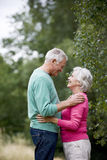 A senior couple looking into each other's eyes, outdoors Royalty Free Stock Image