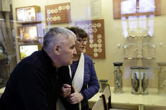 Senior couple looking at exhibit. In museum Royalty Free Stock Photo