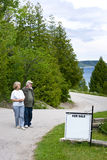 Senior couple looking at home for sale stock photo