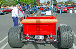 Senior couple looking at a hot rod. Stock Images