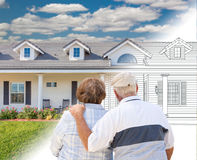 Senior Couple Looking At New House Drawing Gradating Into Photograph. Senior Couple Looking At a New House Drawing Gradating Into Photograph stock image