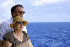Senior couple looking out over water. Attractive senior couple on cruise ship Stock Image