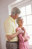 Senior couple looking out their window Royalty Free Stock Images
